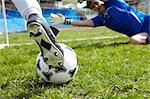 Horizontal image of soccer ball with foot of player kicking it Stock Photo - Royalty-Free, Artist: pressmaster                   , Code: 400-04396270