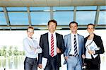 Group of friendly business partners looking at camera outside Stock Photo - Royalty-Free, Artist: pressmaster                   , Code: 400-04397034