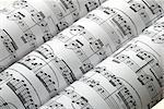 Three music sheets on a row isolated in white Stock Photo - Royalty-Free, Artist: johnkwan                      , Code: 400-04397674