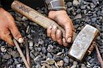 Detail of dirty hands holding hammer and rod - blacksmith Stock Photo - Royalty-Free, Artist: brozova                       , Code: 400-04399262