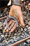 Detail of dirty hand holding horseshoe - blacksmith Stock Photo - Royalty-Free, Artist: brozova                       , Code: 400-04399264