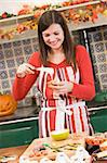 Woman in kitchen making Halloween treats and smiling Stock Photo - Royalty-Free, Artist: MonkeyBusinessImages          , Code: 400-04402166