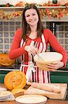 Woman in kitchen making Halloween treats and smiling Stock Photo - Royalty-Free, Artist: MonkeyBusinessImages          , Code: 400-04402169
