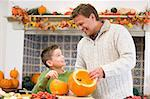 Father and son carving jack o lanterns on Halloween and smiling Stock Photo - Royalty-Free, Artist: MonkeyBusinessImages          , Code: 400-04402190