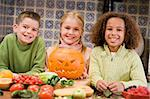 Three young friends on Halloween with jack o lantern and food sm Stock Photo - Royalty-Free, Artist: MonkeyBusinessImages          , Code: 400-04402194