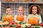 Three young friends on Halloween with jack o lanterns and food s Stock Photo - Royalty-Free, Artist: MonkeyBusinessImages          , Code: 400-04402195