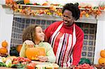 Grandmother and granddaughter making jack o lantern on Halloween Stock Photo - Royalty-Free, Artist: MonkeyBusinessImages          , Code: 400-04402197