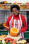 Woman on Halloween making jack o lantern smiling Stock Photo - Royalty-Free, Artist: MonkeyBusinessImages          , Code: 400-04402198