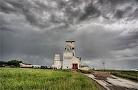 Prairie Grain Elevator in Saskatchewan Canada with storm clouds Stock Photo - Royalty-Freenull, Code: 400-04402394