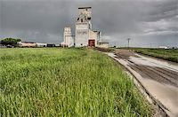 Prairie Grain Elevator in Saskatchewan Canada with storm clouds Stock Photo - Royalty-Freenull, Code: 400-04402395
