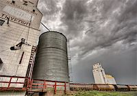 Prairie Grain Elevator in Saskatchewan Canada with storm clouds Stock Photo - Royalty-Freenull, Code: 400-04402396