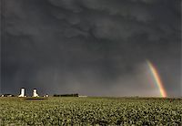 Prairie Grain Elevator in Saskatchewan Canada with storm clouds and rainbow Stock Photo - Royalty-Freenull, Code: 400-04402406
