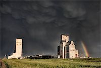 Prairie Grain Elevator in Saskatchewan Canada with storm clouds and rainbow Stock Photo - Royalty-Freenull, Code: 400-04402409