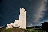 Prairie Grain Elevator in Saskatchewan Canada with storm clouds and rainbow Stock Photo - Royalty-Freenull, Code: 400-04402410