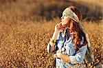 Young Beautiful Woman in a Field During Summertime Stock Photo - Royalty-Free, Artist: tobkatina                     , Code: 400-04402429