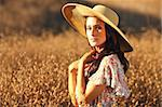 Beautiful Woman in a Field During Summer With Hat Stock Photo - Royalty-Free, Artist: tobkatina                     , Code: 400-04402431