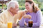 Couple Enjoying A Beverage By A Golf Course Stock Photo - Royalty-Free, Artist: MonkeyBusinessImages          , Code: 400-04404250