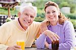 Couple Enjoying A Beverage By A Golf Course Stock Photo - Royalty-Free, Artist: MonkeyBusinessImages          , Code: 400-04404251
