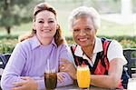 Two Female Friends Enjoying A Beverage By A Golf Course Stock Photo - Royalty-Free, Artist: MonkeyBusinessImages          , Code: 400-04404253