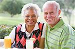 Couple Enjoying A Beverage By A Golf Course Stock Photo - Royalty-Free, Artist: MonkeyBusinessImages          , Code: 400-04404254