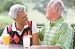 Couple Enjoying A Beverage By A Golf Course Stock Photo - Royalty-Free, Artist: MonkeyBusinessImages          , Code: 400-04404255