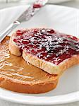 Peanut butter and jelly on pieces of bread. Stock Photo - Royalty-Free, Artist: hojo                          , Code: 400-04414245