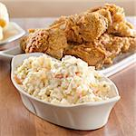 coleslaw with fried chicken in background. Stock Photo - Royalty-Free, Artist: hojo                          , Code: 400-04414281