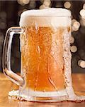 overflowing mug of beer Stock Photo - Royalty-Free, Artist: hojo                          , Code: 400-04414315