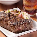 grilled steak with potatoes and cola in background. Stock Photo - Royalty-Free, Artist: hojo                          , Code: 400-04414331