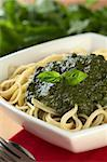 Fresh homemade pesto made of basil, garlic and olive oil served on spaghetti and garnished with a basil leaf (Selective Focus, Focus on the basil leaf on the pesto) Stock Photo - Royalty-Free, Artist: ildi                          , Code: 400-04415291