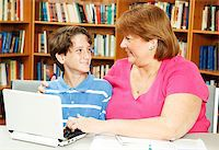 Mother or teacher, helping a little boy study in the library. Stock Photo - Royalty-Freenull, Code: 400-04419057