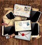 Vintage composition with old style distressed postage design elements and antique photo frames plus some post stickers. Background is wood. Stock Photo - Royalty-Free, Artist: DavidArts                     , Code: 400-04419788