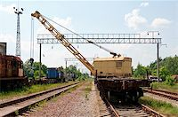 Old Rail Track Mounted Crane with blue sky on background Stock Photo - Royalty-Freenull, Code: 400-04422018