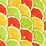 Abstract three-color background with citrus-fruit of grapefruit, orange and lemon slices. Close-up. Studio photography. Stock Photo - Royalty-Free, Artist: boroda                        , Code: 400-04423833