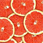 Abstract red background with citrus-fruit of grapefruit slices. Close-up. Studio photography. Stock Photo - Royalty-Free, Artist: boroda                        , Code: 400-04423835