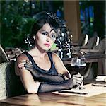 Fashion woman retro portrait in a restaurant Stock Photo - Royalty-Free, Artist: GoodOlga                      , Code: 400-04424043