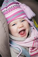 Close-up of Baby Girl Sitting in Car Seat wearing Winter Clothing Stock Photo - Premium Royalty-Freenull, Code: 600-04425024