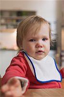 sad girls - Portrait of Sad Baby Girl Sitting in High Chair Stock Photo - Premium Royalty-Freenull, Code: 600-04425164