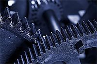 An old and dirty industrial gears background. Shallow DOF Stock Photo - Royalty-Freenull, Code: 400-04427641