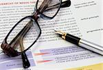 eyeglasses and fountain pen on the opened book Stock Photo - Royalty-Free, Artist: AlexStar                      , Code: 400-04434499