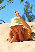 preteen girl feet - Young girl in yellow hat lying on top of a sand dune Stock Photo - Royalty-Freenull, Code: 400-04439093