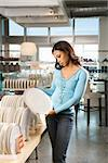 African American female shopping for plates in retail setting. Stock Photo - Royalty-Free, Artist: iofoto                        , Code: 400-04450259