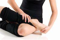 feet gymnast - legs in black knee socks warming up  Stock Photo - Royalty-Freenull, Code: 400-04458037