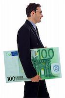 Happy businessman walking with a big hundred euro Stock Photo - Royalty-Freenull, Code: 400-04459395