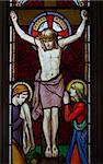 detail of victorian stained glass church window in Fringford depicting Jesus nailed to the cross with St. Mary and St. John at the feet of the cross Stock Photo - Royalty-Free, Artist: hospitalera                   , Code: 400-04464598
