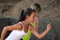 sweaty woman - Mother coaching her teenage daughter Stock Photo - Royalty-Freenull, Code: 400-04465111