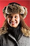 Young adult Caucasian woman wearing fur hat looking to side and smiling. Stock Photo - Royalty-Free, Artist: iofoto                        , Code: 400-04465225