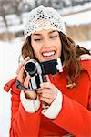 Smiling Caucasian young adult female in winter clothing pointing video camera at viewer. Stock Photo - Royalty-Free, Artist: iofoto                        , Code: 400-04465241