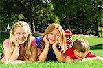 Portrait of a family - mother and children - relaxing in summer park Stock Photo - Royalty-Free, Artist: Elenathewise                  , Code: 400-04465286