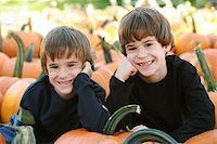 Boys Resting on a Pumpkin in the Pumpking Patch Stock Photo - Royalty-Freenull, Code: 400-04465793